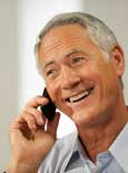 Image of a smiling man on a telephone